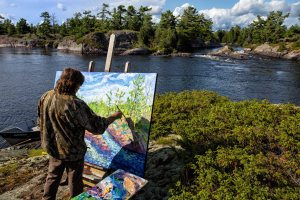 Sabourin paints at the Jump in the French River Delta Land of the Voyageur